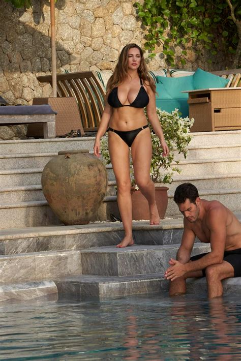 kelly brook wears a black bikini while relaxing by the